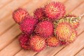 Rambutan fruits on blurred background — Stock Photo