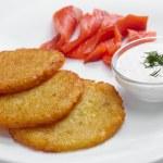 Potato pancakes with salmon — Stock Photo #66301507