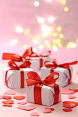 Gifts with red ribbons — Stock Photo