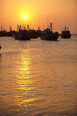 Silhouettes of boats at sunset — Stock Photo