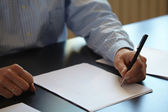 Man with pen in hand — Stock Photo