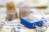 Padlock on dollar banknotes — Stock Photo