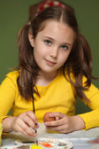 Girl painted Easter eggs — Stock Photo