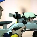 Woman aiming a pneumatic air rifle — Stock Photo #71041731