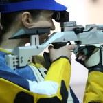 Woman aiming a pneumatic air rifle — Stock Photo #72877575