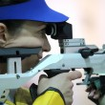 Woman aiming a pneumatic air rifle — Stock Photo #72878049
