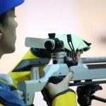 Woman aiming a pneumatic air rifle — Stock Photo #76281825