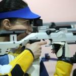 Woman aiming a pneumatic air rifle — Stock Photo #76281895