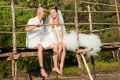 Love story on a wooden bridge — Stockfoto