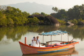 Love story in wooden boat — Foto de Stock