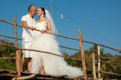 Love story on a wooden bridge — Photo