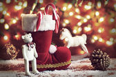 boots, rocking horse, and teddy bear on christmas background — Φωτογραφία Αρχείου