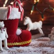 Boots, rocking horse, and teddy bear on christmas background — Photo #56085923