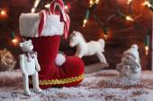 Boots, rocking horse, and teddy bear on christmas background — ストック写真