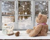 Teddy bear and rocking horse looking at snowy day — Stok fotoğraf