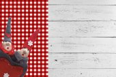 Christmas elves on wooden background — Stock Photo