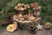 Chistmas composition with cinnamon, nuts and fir branches. — Stock Photo