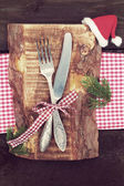 Knife and fork in Christmas table setting — Stock Photo
