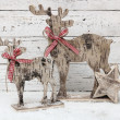 Christmas Reindeer on wooden background in scandinavian style — Stock Photo #59173615