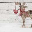 Christmas Reindeer on wooden background in scandinavian style — Stock Photo #59173661