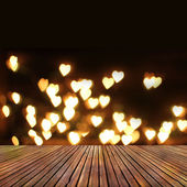 wooden deck table over heart bokeh background. Valentine's day  — 图库照片