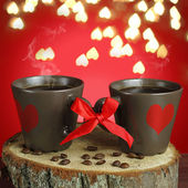 Two cups of coffee with ribbons. Valentine card. — Stock Photo