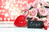 Valentine Card.Roses and Hearts on natural bokeh. — Stock Photo