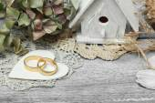 Pair of wedding rings on old style background — Stock Photo