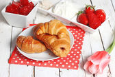 Breakfast with croissants, strawberry  and cup of coffee on whit — Stock Photo