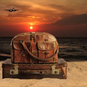 Baggage on a beach. Concept for travel agents — Stock Photo