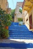 Steps of alleyway leading upwards Symi Greece — Stock Photo