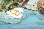 Pair of wedding rings on old style background — 图库照片