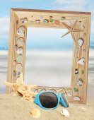 Summer background of shell on the sand and frame — Stock Photo