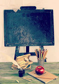 Back to school - blackboard and school equipment in old style — Stock Photo