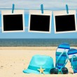 Blank instant photos hanging on clothesline at the beach — Stock Photo #77881124