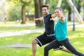 Friends work out in park — Stock Photo