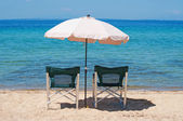 Chairs and umbrella on the beach — Stock Photo