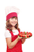 Beautiful little girl cook with spaghetti — Stockfoto