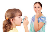 Little girl using inhaler due to smoke — Stock Photo