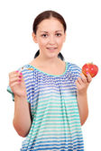 Girl holding a broken cigarette and apple  — Stock Photo