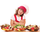 Happy little girl cook with salmon sea food — Foto Stock