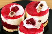 Three sweet raspberry cakes closeup — Стоковое фото