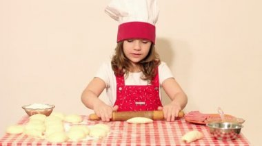 Little girl cook kneading dough and make roll — Stock Video