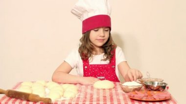 Little girl cook kneading dough — Stock Video