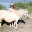 White pony horse and little girl — Stock Video #56806225