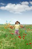 Happy little girl playing on meadow spring season — Stock Photo
