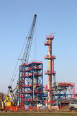 New refinery construction site with machinery — Stock Photo
