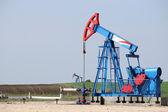 Two oil pump jack on oilfield — Stock Photo