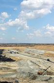 Open pit coal mine with excavator industry — Stock Photo