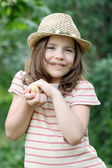 Little girl holding cute yellow chicken — Stock Photo